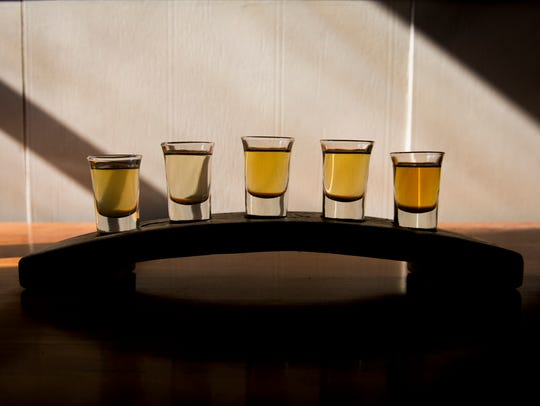 A flight of various meads from Trazo Meadery sit in