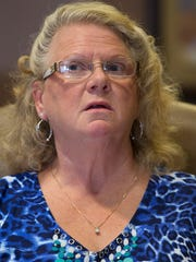 Linda Iseler shared her story at her attorney's office in Fort Wayne on Thursday, July 28, 2016. Iseler's ex-husband, Richard Hoagland, left her and their family unexpectedly in 1993 and was recently found to be living in Florida under the stolen identity of a dead man.