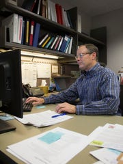 Iowa City public works director Rick Fosse works at