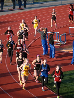 Runners compete in the 800 meter race at the Creek Classic Relays at Clear Creek Amana on Friday.