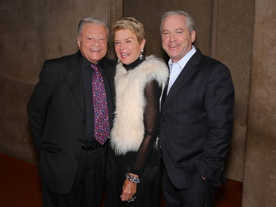 From left, presenting gold sponsors Harold Matzner and Donna MacMillan with Bill Nicholson.