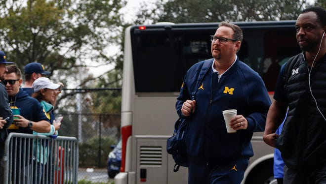 Michigan Wolverines offensive coordinator Tim Drevno arrives for the Outback Bowl at Raymond James Stadium in Tampa, Fla., Monday, Jan. 1, 2018.