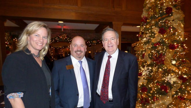 BBCC Ambassador Peggy Kerr, of Judson Center, and recent Michigan Business Professional Association Community Leader Award winner; BBCC President Joe Bauman and John Schrot of Berry Moorman in Birmingham.