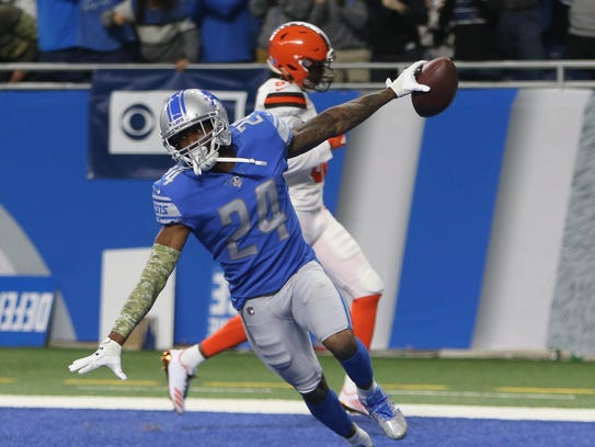 Detroit Lions' Nevin Lawson celebrates his 44-yard