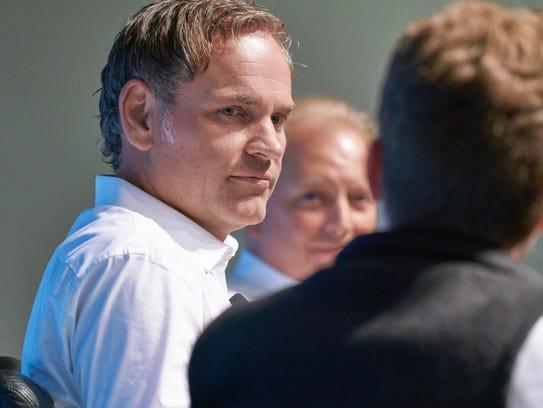 Porsche CEO Oliver Blume, left, and head of Porsche
