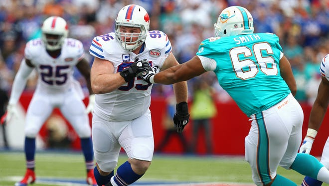 Bills Kyle Williams (95) works against Shelley Smith (66) during Sunday's game.