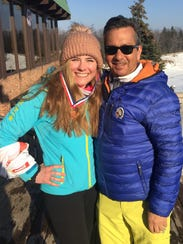 Olivia Weymouth with Marian ski coach Robert Rhaodes at the Pine Knob regional Feb. 14.