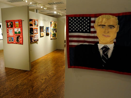 Portrait quilts by Riche' Richardson are displayed