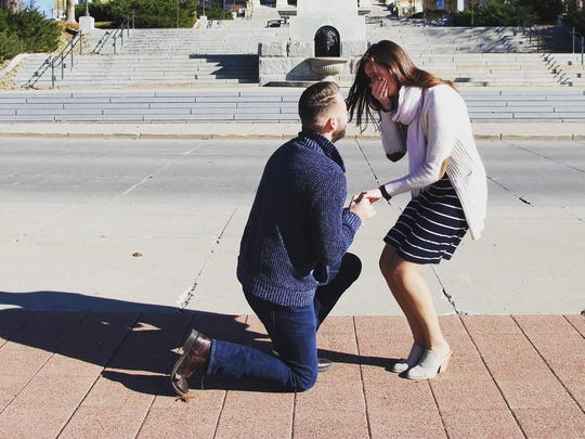 Ryan Moon, 26, and Haley Smith, 25, both of West Des Moines, got engaged outside the Iowa State Capitol in Des Moines on Sunday, Nov. 19, 2017.