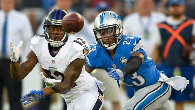 Ravens receiver Mike Wallace catches a pass in front of Lions cornerback Darius Slay in the first half of an exhibition game Aug. 27, 2016 in Baltimore.