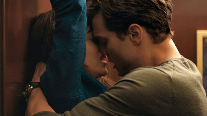 """Associated PressDakota Johnson (left) and Jamie Dornan appear in a scene from """"Fifty Shades of Grey."""" Religious and other groups say the new movie is degrading to women and endorses sexual violence."""
