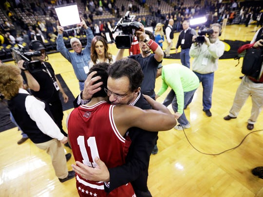 Indiana guard Yogi Ferrell (11) gets a hug from coach Tom Crean after an NCAA college basketball game against Iowa, Tuesday, March 1, 2016, in Iowa City, Iowa. Ferrell scored 20 points as Indiana won 81-78 and clinched the Big Ten title. (AP Photo/Charlie Neibergall)