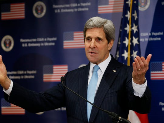 Secretary of State John Kerry in Kiev, Ukraine, spoke with reporters after he walked the streets where nearly 100 anti-government protesters were gunned down by police last month, and promised beseeching crowds that American aid is on the way.