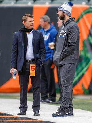 Indianapolis Colts general manager Chris Ballard talks with Colts quarterback Andrew Luck (12) before the Cincinnati Bengals game at Paul Brown Stadium in Cincinnati on Sunday, Oct. 29, 2017.