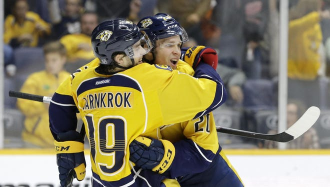 Predators forward Miikka Salomaki, right, celebrates with Calle Jarnkrok (19) after Salomaki scored a goal in the second period Tuesday.