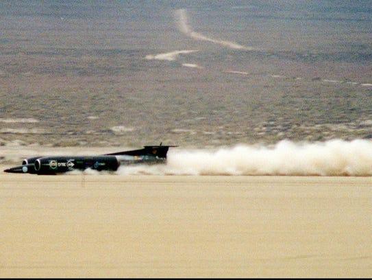 Thrust SSC speeds across the Black Rock Desert about