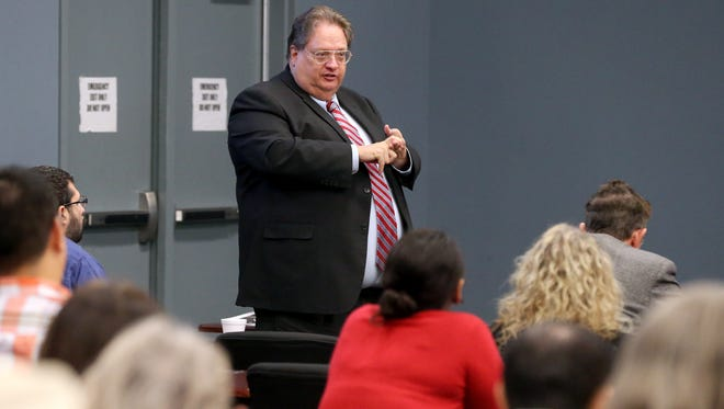 Nueces County District Attorney Mark Skurka talks during the Stop the Silence on Domestic Violence Summit on Friday, Dec. 2, 2016, at the Del Mar College Center for Economic Development in Corpus Christi.