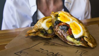 Carole Meyer, a native of North Africa, runs Zookz, a toasted sandwich shop inspired by her grandmother, who made these sandwiches when Meyer was a little girl.  The shop is located at 100 E. Camelback Road in Phoenix. This is a #22, a poached egg breakfast sandwich.