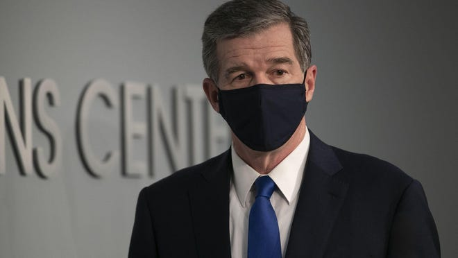 North Carolina Governor Roy Cooper arrives for a press briefing on the COVID-19 virus at the Emergency Operations Center June 24 in Raleigh.