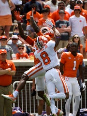 Clemson wide receiver Tee Higgins (5) attempts to catch the ball as Clemson defensive back A.J. Terrell (8) defends the 2018 spring football game on Saturday, April 14, 2018.