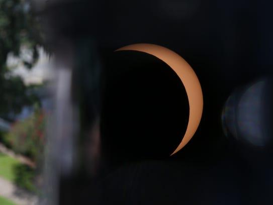 Monday's solar eclipse viewed through a telescope set