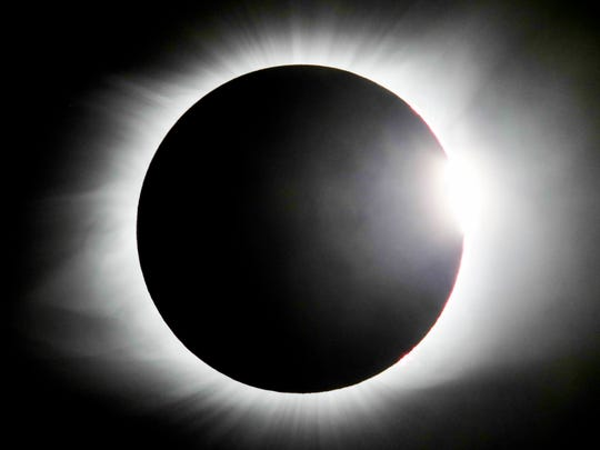 The diamond ring effect is displayed throughout the solar eclipse.