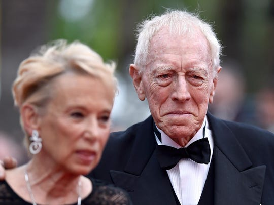 "Actor Max Von Sydow and wife Catherine Brelet attend ""The BFG (Le Bon Gros Geant - Le BGG)"" premiere during the 69th annual Cannes Film Festival in 2016. Von Sydrow, star of ""The Exorcist"" and many other films, died Sunday at the age of 90."