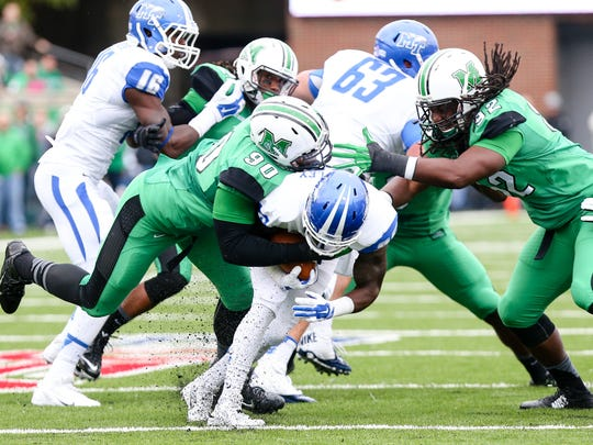 MTSU running back Reggie Whatley gets tackled in the