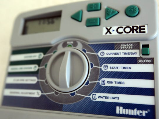 A Hunter X-Core control box mounted in the garage of a model home includes water settings, seen on Wednesday, June 4, 2014 at KB Home's Las Playas community in Coachella.