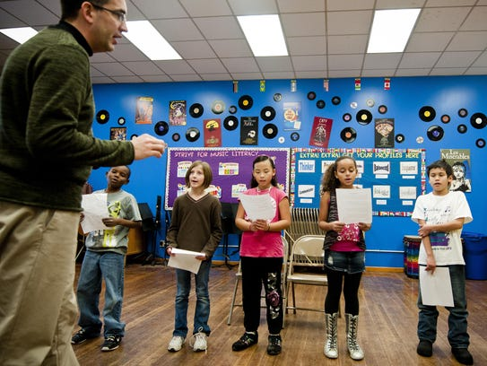 Chappell Elementary music teacher Kevin Flogel leads