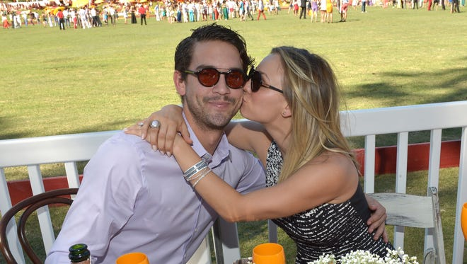 Kaley Cuoco plants one on Ryan Sweeting at the Fourth-Annual Veuve Clicquot Polo Classic, Los Angeles at Will Rogers State Historic Park on Oct. 5, 2013 in Pacific Palisades, Calif.
