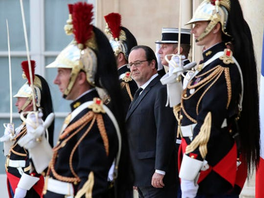 "FILE - In this Wednesday, June 15, 2016 file picture, French President Francois Hollande is surrounded by Republican Guards as he waits for Finland's Prime Minister Juha Sipila before their talks at the Elysee Palace in Paris, France. French President Francois Hollande says he decided against running for another term because he wants to give his Socialist party a chance to win ""against conservatism and extremism."""