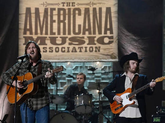 FILE - In this Sept. 17, 2014 file photo, Sturgill Simpson, left, performs during the Americana Music Honors and Awards show in Nashville, Tenn.  Top Grammy contenders Simpson and Chance the Rapper are set to perform at the awards show this month. The Recording Academy announced Thursday, Feb. 2, 2017 that fellow nominee William Bell and Grammy winners Little Big Town and Gary Clark Jr. will also perform on the live telecast on Feb. 12.