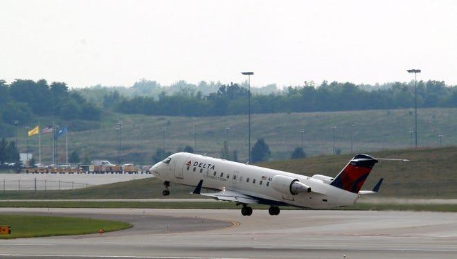 A Delta jet takes off from Cincinnati/Northern Kentucky International Airport.
