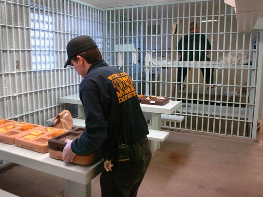 A detention officer brings meals into a cell block at the Wichita County Jail in this file photograph. The biggest issue for the county in 2016 was trying to decide what to do about its jail facilities, plagued by overcrowding and maintenance issues.