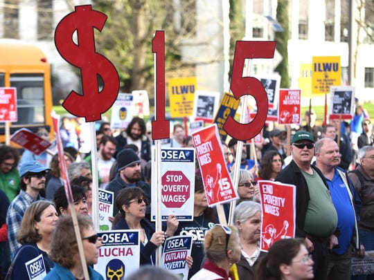 Protestors in support of raising the minimum wage to $15 an hour attend a rally at Oregon State Capitol on Jan. 24, in Salem.
