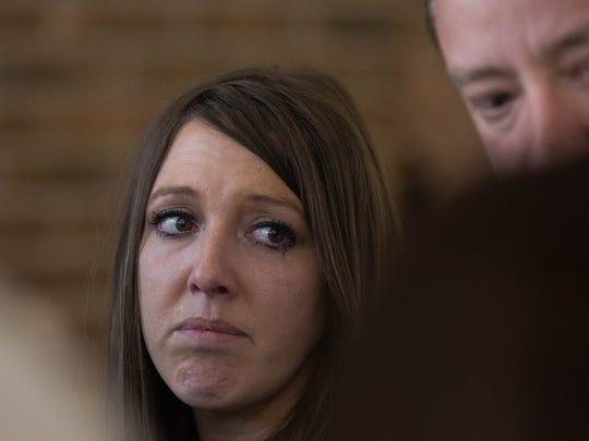 Sarah Martin, widow of Jeremy Martin, and James Martin, Jeremy's brother, speak with the media gathered outside the courtroom Tuesday May 23, 2017 after a mistrial was declared for the second time in the Tai Chan trial. Chan was being tried in for the alleged murder of Jeremy Martin.