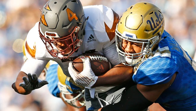 Arizona State's Demario Richard (4) is tackled by UCLA's Aaron Wallace (51) in the first quarter on Oct. 3, 2015, at the Rose Bowl in Pasadena, Calif.