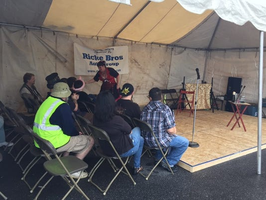 Onlookers watch a magic trick  at the first ever Mystic Faire of Gettysburg on Saturday, Sept. 12.