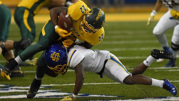 NDSU's King Frazier (22) is stopped by SDSU's Anthony