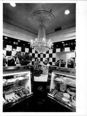 Chef Anne Sterling arranges bread under the Waterford crystal chandelier at Edwards food store.  The store was in a renovated room just left of the main entrance to Edwards Restaurant.