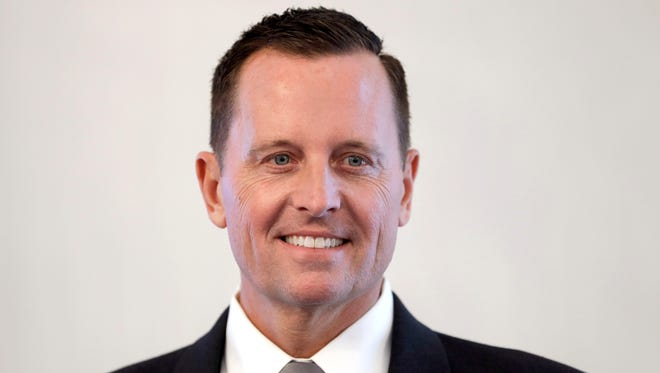 In this May 8, 2018 file photo U.S. Ambassador to Germany, Richard Allen Grenell, poses for the media prior to his accreditation by German President Frank-Walter Steinmeier at the Bellevue palace in Berlin.
