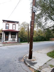 A memorial to Sam DuBose was removed at utility pole at Rice and Valencia Streets before the jurors in the murder trial of former University of Cincinnati police officer Ray Tensing made a trip to the scene of the July 19, 2015 fatal shooting of DuBose in Mount Auburn Tuesday Nov. 1, 2016.