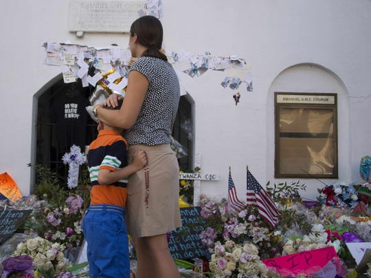 Visitors pause outside Emanuel AME Church in Charleston,