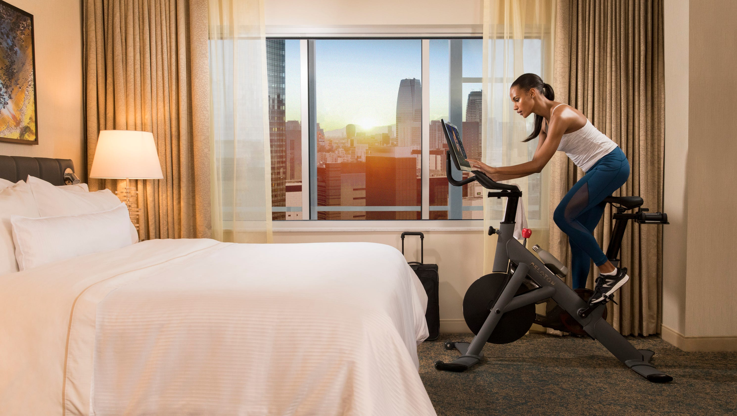 workout amenity peloton bikes in hotel rooms. Black Bedroom Furniture Sets. Home Design Ideas