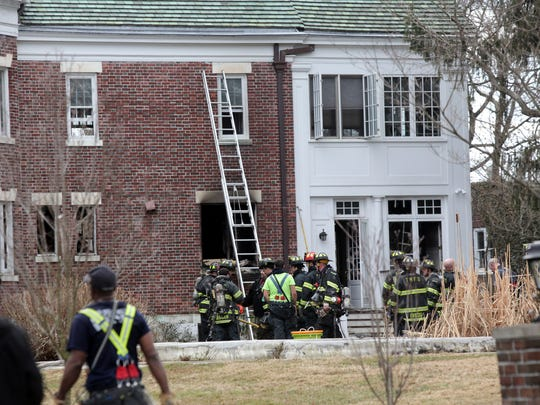 Firefighters put out a fire at 37 Woodbine Ave in Larchmont on March 20, 2014.