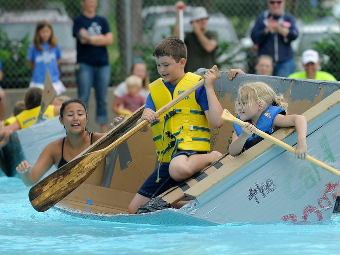 Wyatt Hermsen and his sister, Allie take part in the great cardboard boat race at Kuehn Park Pool in Sioux Falls, S.D., Saturday, July, 12, 2014.  The 3rd annual event had 31 vessels register.