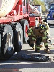Firefighters from Hamburg, Lyon, Green Oak and Unadilla