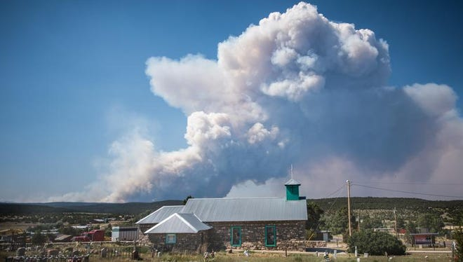The Dog Head Fire burns as seen from the town of Tajique, near the Manzano Mountains on Wednesday, June 15, 2016, in Tajique, N.M. Authorities don't have a containment estimate yet for a wildfire burning in the Manzano Mountains southeast of Albuquerque.