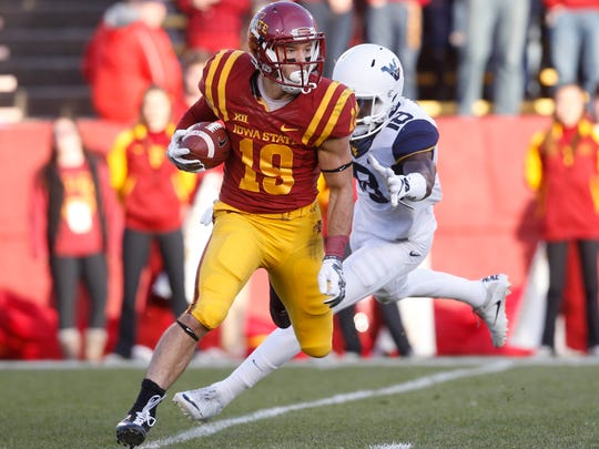 Iowa State wide receiver Trever Ryen turns down field as West Virginia safety Marvin Gross Jr. defends Saturday, Nov. 26, 2016, at Jack Trice Stadium in Ames.